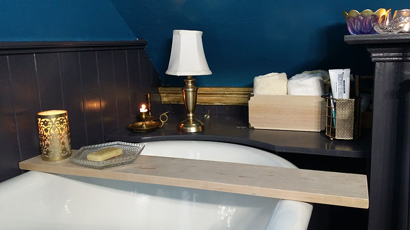 Custom woodwork behind the bathtub.
