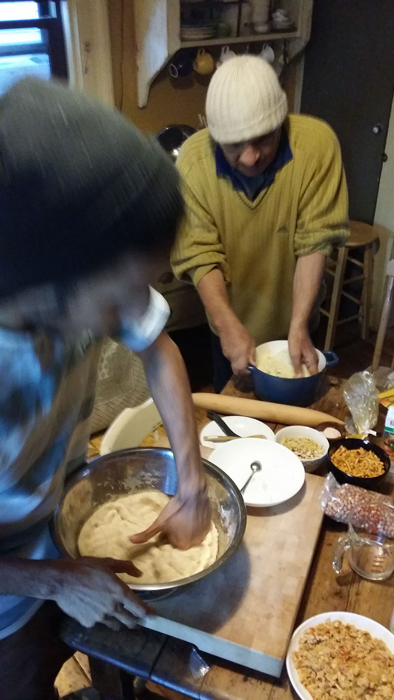 beating down dough for parathas